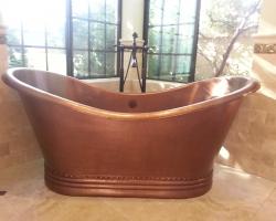 Remodeled bathroom with bronze old fashioned bathtub