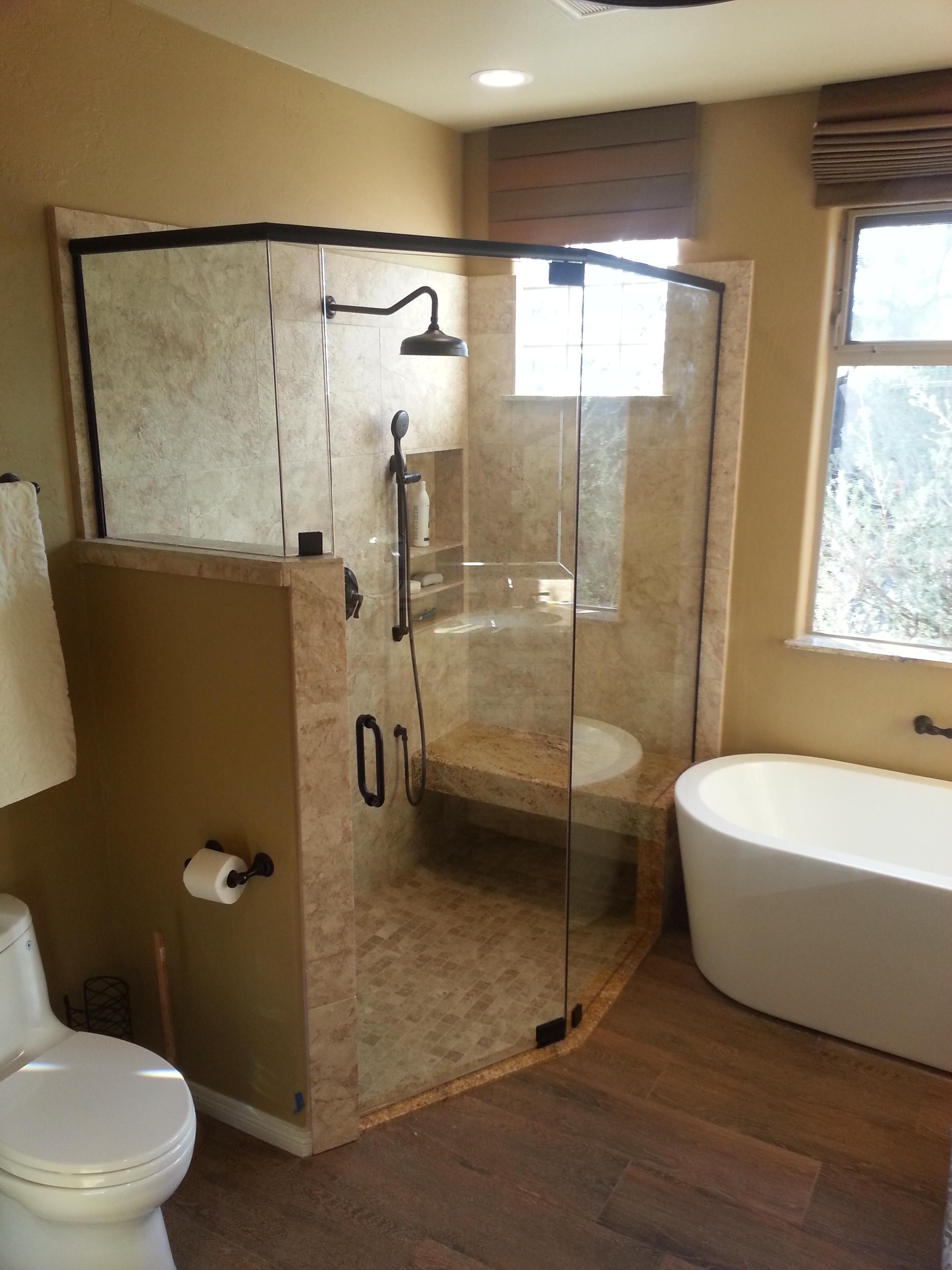 Remodeled bathroom with glass encased shower